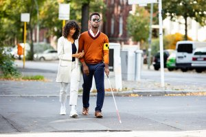 Young Woman and Blind Man On Street