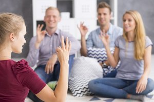 group young people communicate of sign language